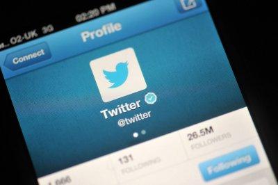 """В Twitter откажутся от """"собаки"""" перед именем"""