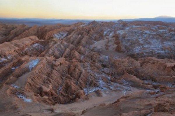 Ученые: На Марсе бывает снег, а на Юпитере - шторм