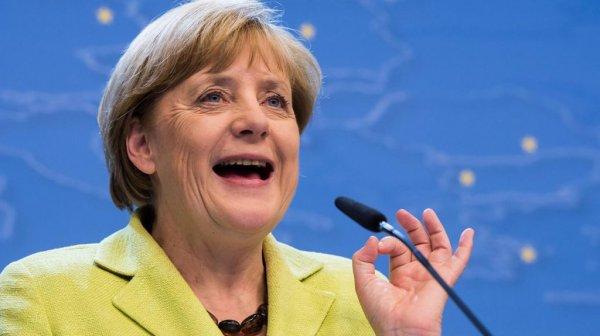 Меркель пообещала Путину поговорить с Порошенко о минских соглашениях